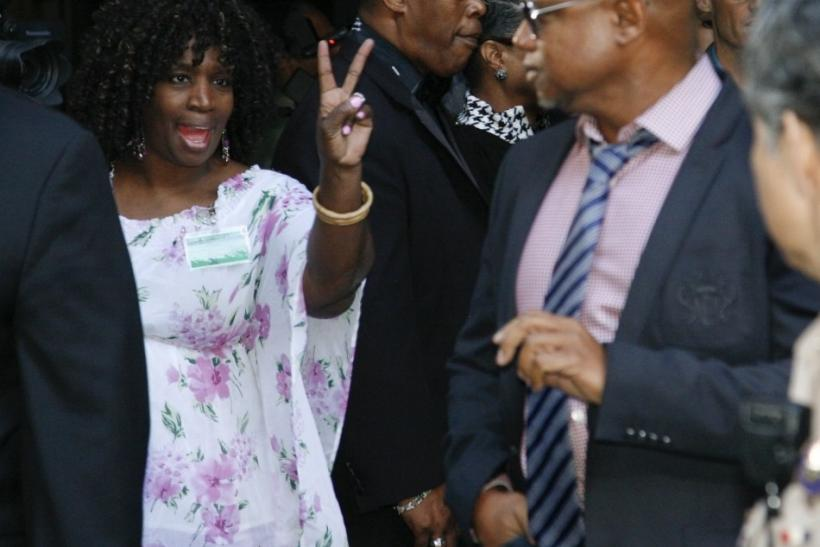 A fan flashes a victory sign as Randy Jackson leaves the sentencing hearing of Dr. Conrad Murray in Los Angeles