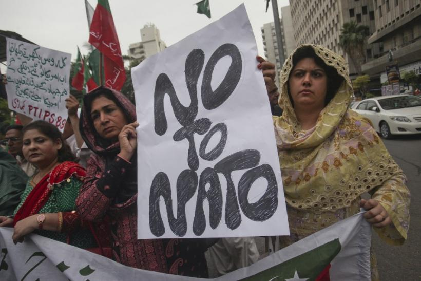 Supporters of Pakistan Tehreek-i-Insaf hold a placard while taking part in an anti-American demonstration in Karachi