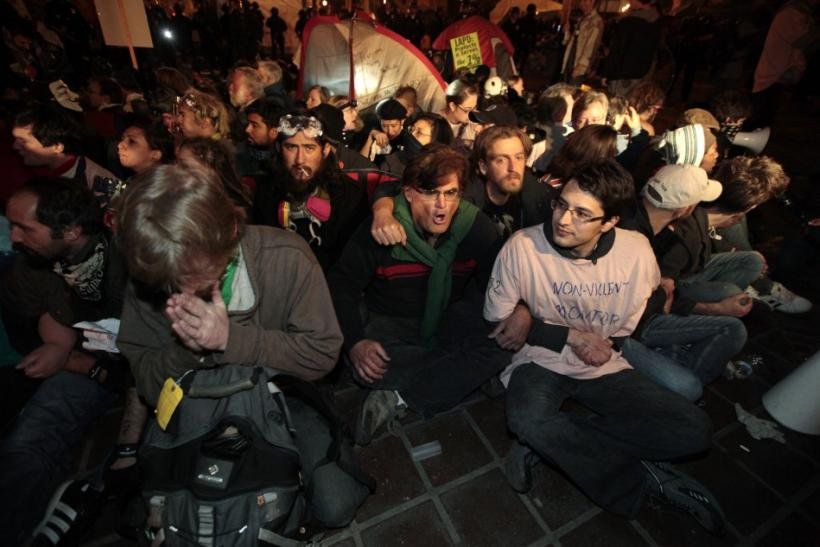 Protesters wait to be arrested at the Occupy LA encampment outside City Hall in Los Angeles