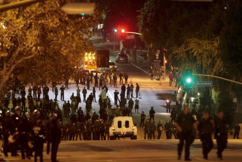 Police take over the streets as protesters from the Occupy LA encampment outside City Hall face eviction in Los Angeles