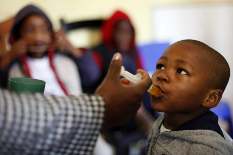 A boy receives medication at Nkosi's Haven, south of Johannesburg November 25, 2011. Nkosi's Haven provides residential care for destitute HIV-positive mothers and their children.