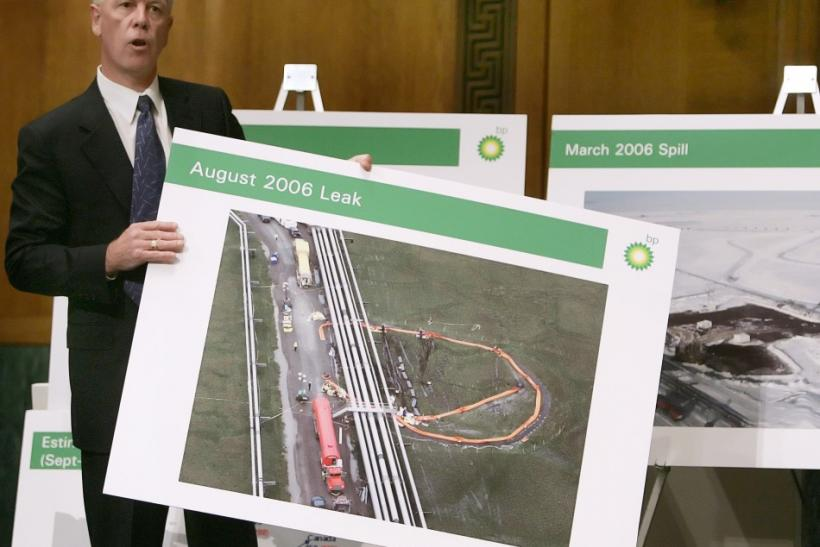 BP Exploration Alaska holds a picture of the 2009 spill.