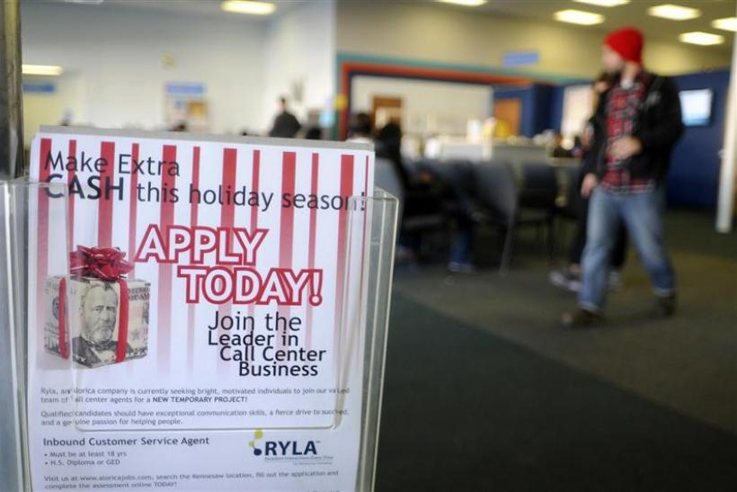A flyer advertising holiday job listings is seen at the North Metro Department of Labor Career Center in Atlanta