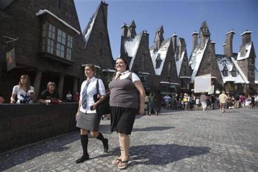 Guests tour the Wizarding World of Harry Potter theme park at the Universal Studio Resort during its grand opening in Orlando, Florida