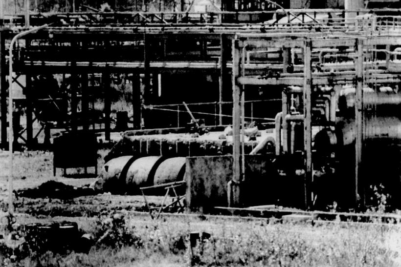 The underground three-flanged stainless steel tank (lower left foreground) at Union Carbide's Bhopal factory from which poison gas leaked last December, killing 2,500