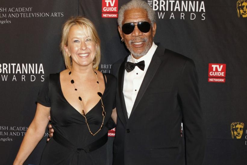 Sarah Cairns and actor Morgan Freeman (R) pose as they arrive at the British Academy of Film and Television Arts Los Angeles Britannia Awards in Beverly Hills, California