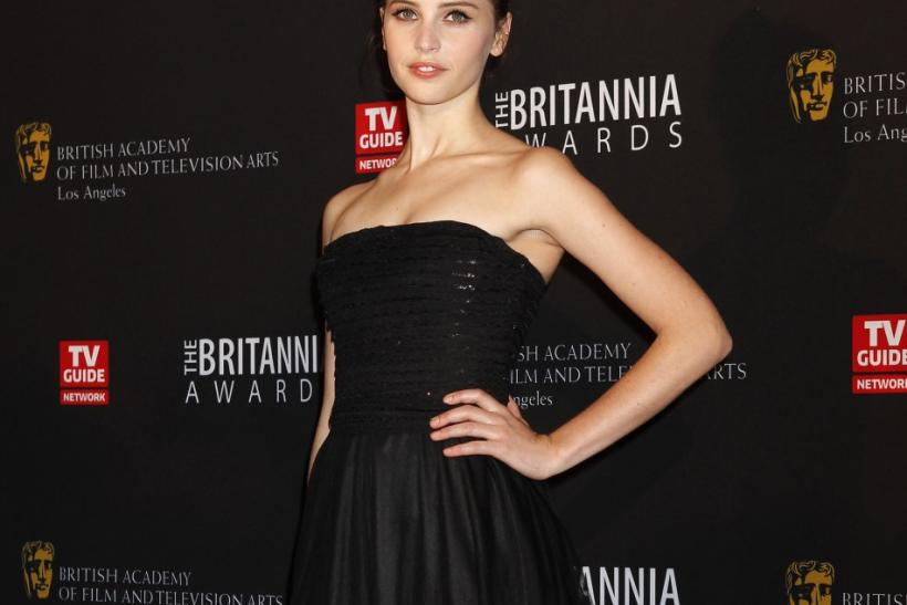 British actress Felicity Jones poses as she arrives at the British Academy of Film and Television Arts Los Angeles Britannia Awards in Beverly Hills, California