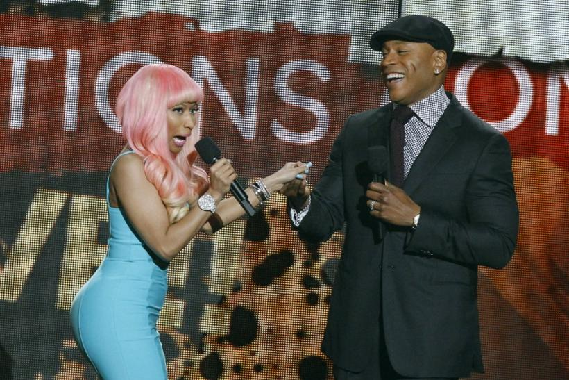 Presenter Nicki Minaj and host LL Cool J greet each other on stage during a concert announcing nominations for the 2012 Grammy Awards at the Nokia theatre in Los Angeles