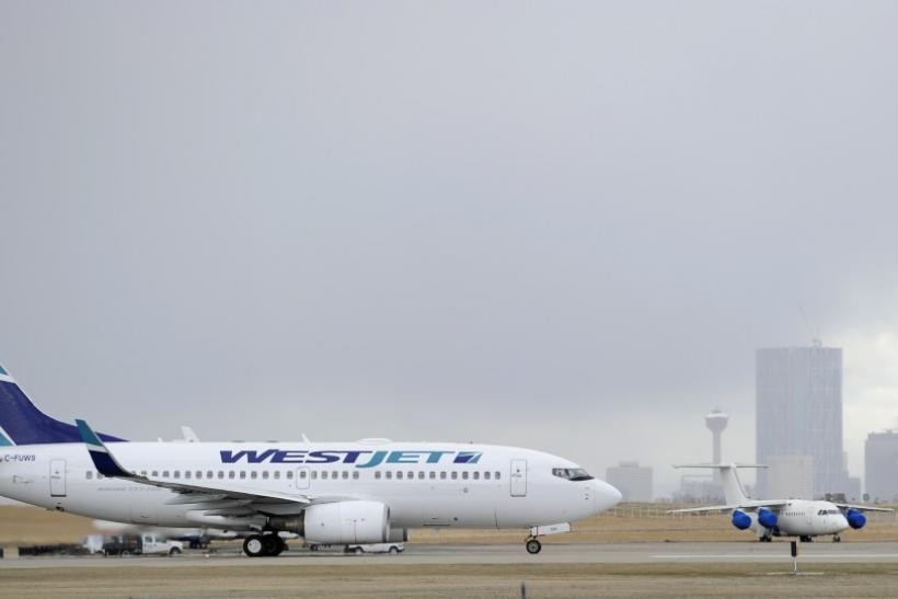 WestJet warns later bookings to hold back revenue