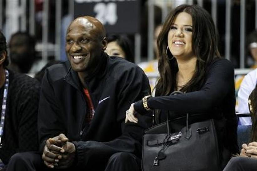 Los Angeles Lakers' Lamar Odom and his wife television personality Khloe Kardashian sit courtside as they attend the 2011 BBVA All-Star Celebrity basketball game as a part of the NBA All-Star basketball weekend in Los Angeles