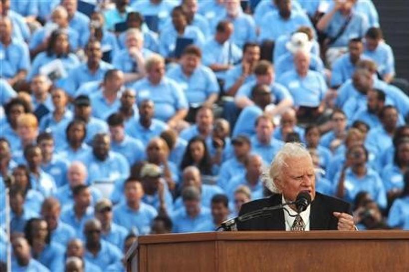 Evangelist Billy Graham speaks during the final day of his Crusade at Flushing Meadows Park in New York