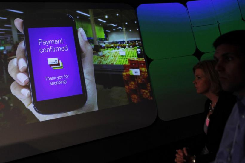 Attendees watch a demonstration of the Google wallet application screen during a news conference unveiling the mobile payment system in New York
