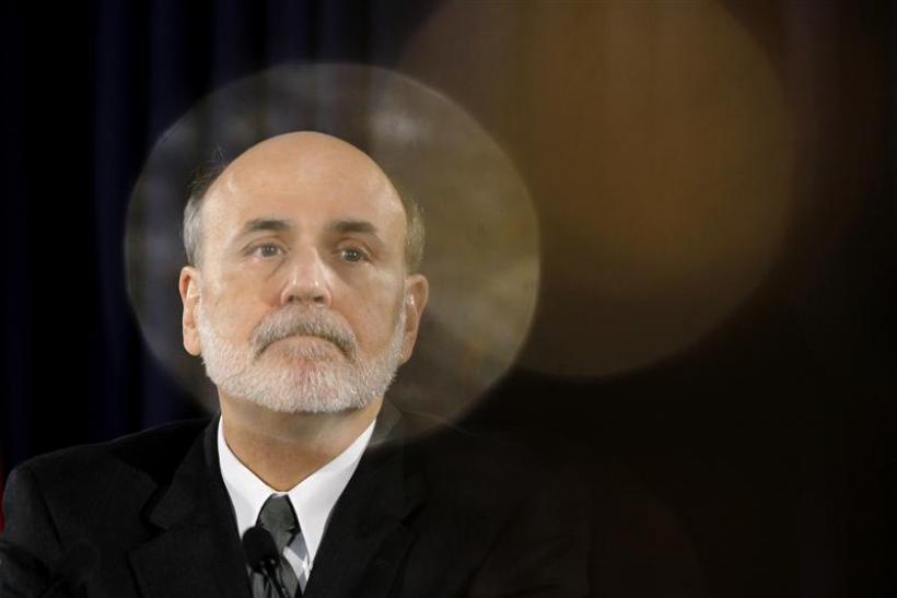 U.S. Federal Reserve Chairman Ben Bernanke pauses during a news conference following a two-day policy session in Washington