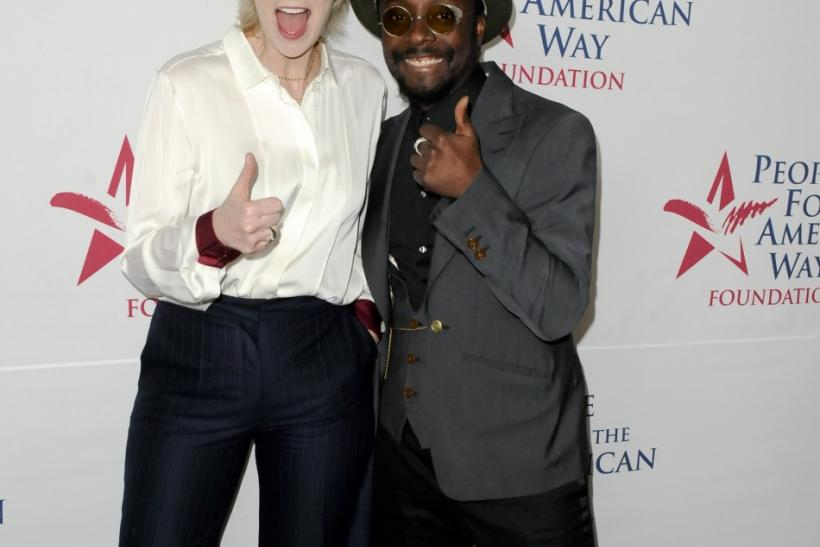 Actress Jane Lynch (L) and musician will.i.am arrive at the 30th anniversary of the People For The American Way Foundation celebration in Beverly Hills, California