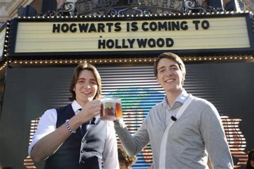 Actors James (L) and Oliver Phelps toast with ''butterbeer'' following an announcement of the new ''The Wizarding World of Harry Potter'' attraction to be built at Universal Studios Hollywood in Los Angeles