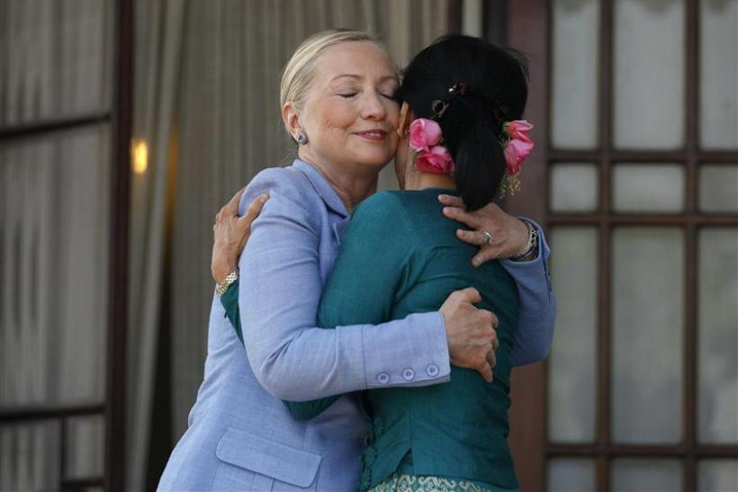 Secretary of State Hillary Clinton hugs Myanmar's pro-democracy leader Aung San Suu Kyi in Yangon December 2, 2011.