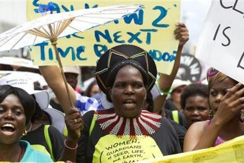 Environmental activists demonstrate outside the United Nations Climate Change conference (COP17) in Durban December 3, 2011. The protest march was part of a Global Day of Action to demand a fair climate change deal.