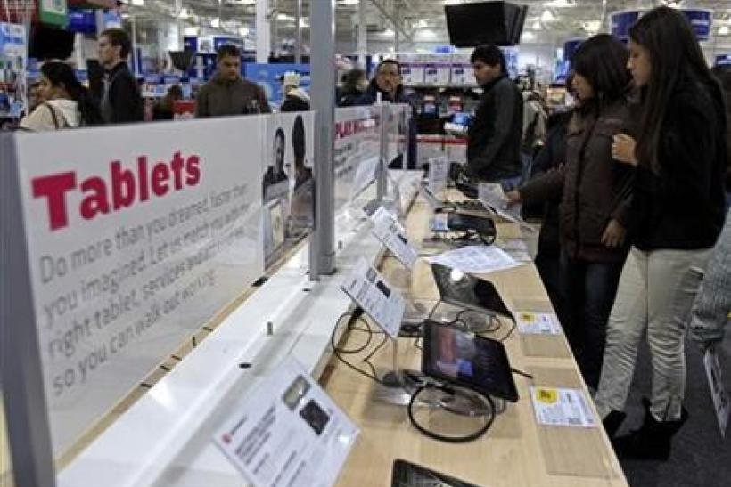 Shoppers look at tablet computers at a Best Buy Store on the shopping day dubbed ''Black Friday'' in Framingham, Massachusetts November 25, 2011.