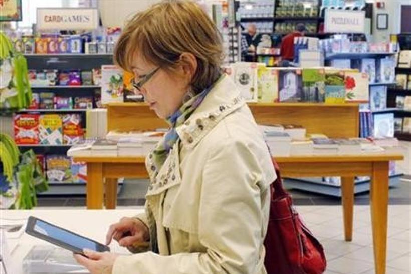 A customer examines a Nook e-reader at a Barnes and Noble store in Boston, March 18, 2011.