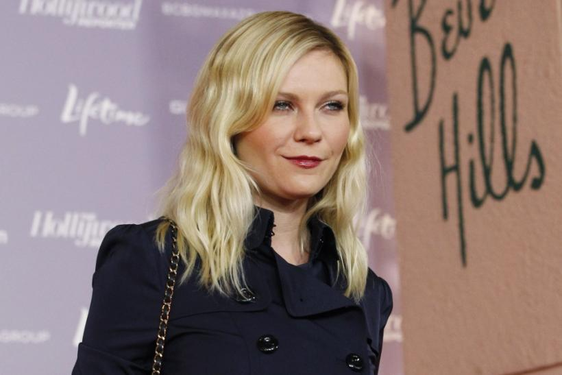 Actress Kirsten Dunst poses at The Hollywood Reporter's 20th annual Women in Entertainment breakfast in Beverly Hills, California