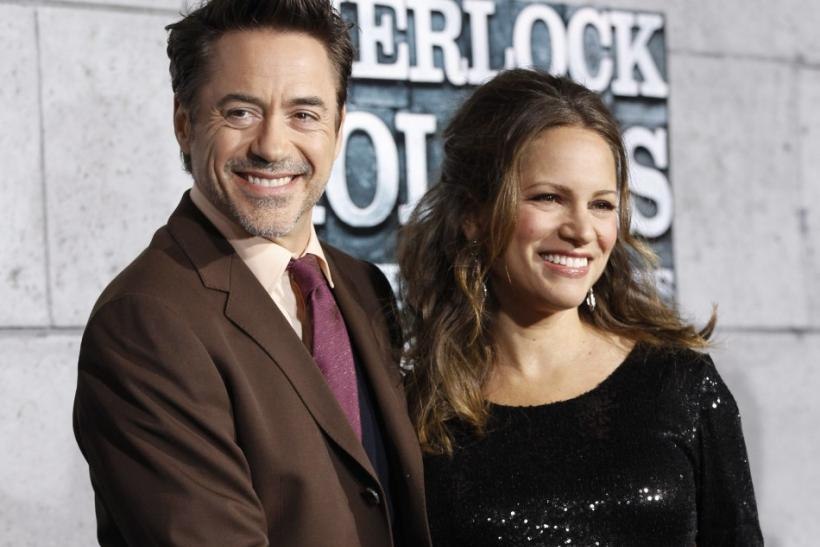"Cast member Robert Downey Jr. (L) touches the belly of his wife Susan at the premiere of ""Sherlock Holmes: A Game of Shadows"" at the Village theatre in Los Angeles, California"