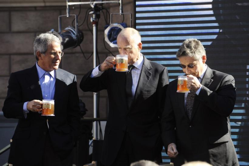 "Universal Studios President and COO Ron Meyer (L), California Governor Jerry Brown (L) and Warner Bros. Chairman and CEO Barry Meyer sample ""butterbeer"" during an announcement of the new ""The Wizarding World of Harry Potter"" attraction"