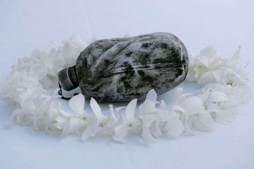 A blackened canteen recovered from Shizuoka, Japan, after two American B-29's collided during a bombing run, is seen on board the USS Arizona Memorial on the 70th anniversary of the attack on Pearl Harbor at the World War II Valor in the Pacific National