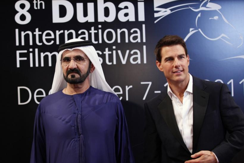 Sheikh Mohammed bin Rashid Al Maktoum (L), vice-president of the UAE and ruler of Dubai, poses at the red carpet with U.S. actor Tom Cruise as they arrive during the opening ceremony of the 8th Dubai International Film Festival for the premiere of Cruise&