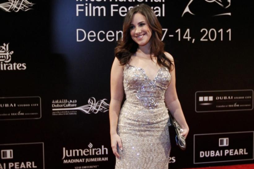 Egyptian actress Sherine Adel poses as she arrives for the opening ceremony of the 8th Dubai International Film Festival