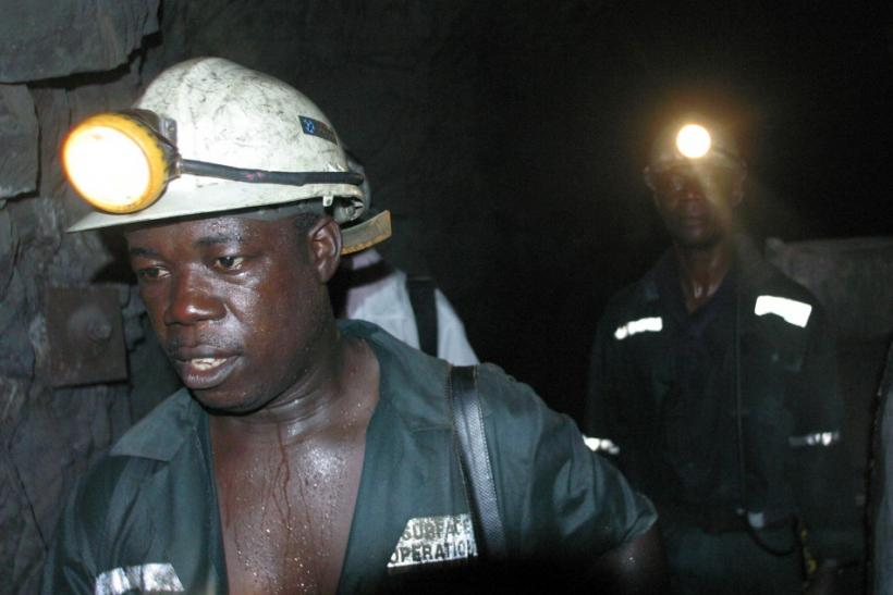 Workers in Abuasi gold mine in Ghana