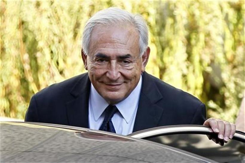 Former IMF chief Strauss-Kahn leaves the financial brigade in Paris