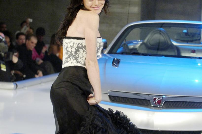 Lindsay Lohan takes to the runway during GM ten, General Motors' annual fashion show, in Los Angeles