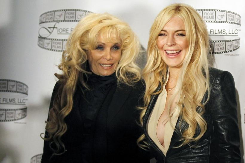 "Actress Lindsay Lohan poses with Victoria Gotti (L) after a news conference to promote the film ""Gotti:Three Generations"" in New York"