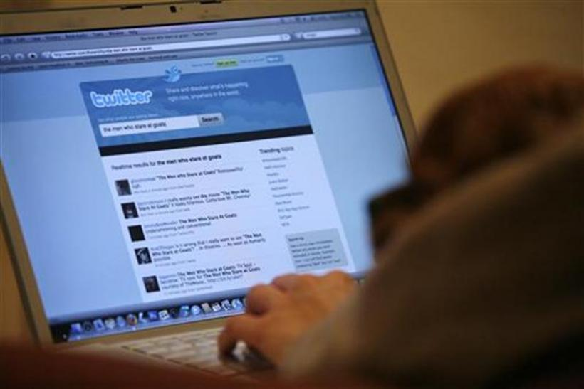 A Twitter page is displayed on a laptop computer in Los Angeles