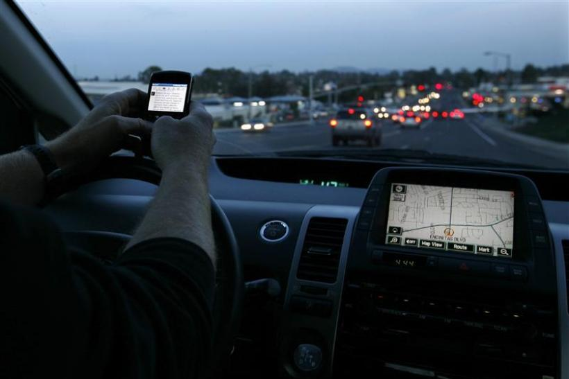 A driver uses his smart phone while in traffic in Encinitas, California