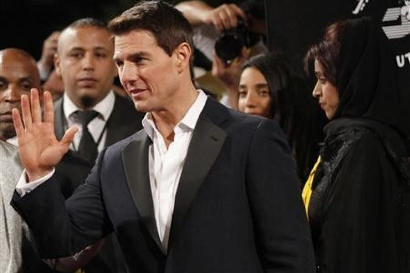 U.S. actor Tom Cruise waves as he arrives at the opening ceremony of the 8th Dubai International Film Festival for the premiere of his new movie ''Mission Impossible: Ghost Protocol''