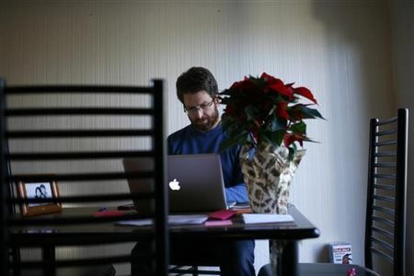Karel Baloun works on his computer at his home in Lafayette, California, December 2, 2011. Facebook's IPO has been long anticipated, but veterans of other startups that have gone public say the period after could be fraught with new challenges. One s