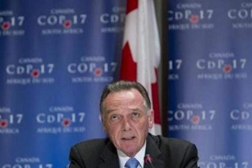 Canada's Environment Minister Peter Kent addresses the media at the United Nations Climate Change Conference (COP17) in Durban December 6, 2011. The city is hosting the conference which runs until December 9.