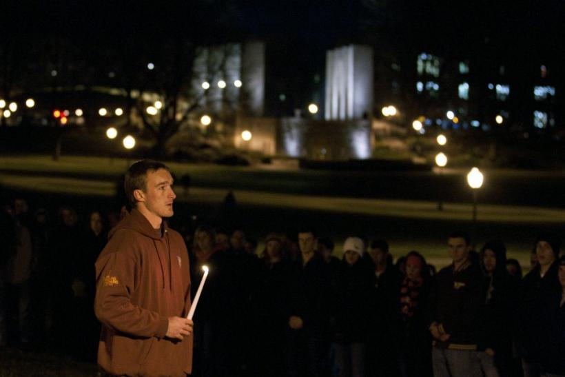 Virginia Tech student Chris Mundy speaks to fellow students at an impromptu memorial for the Virginia Tech police officer who was killed earlier on campus at Virginia Tech University Blacksburg, Virginia
