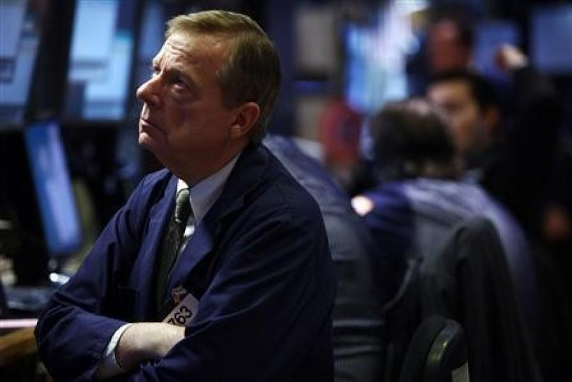 A trader works on the floor of the New York Stock Exchange in New York Dec. 8, 2011.