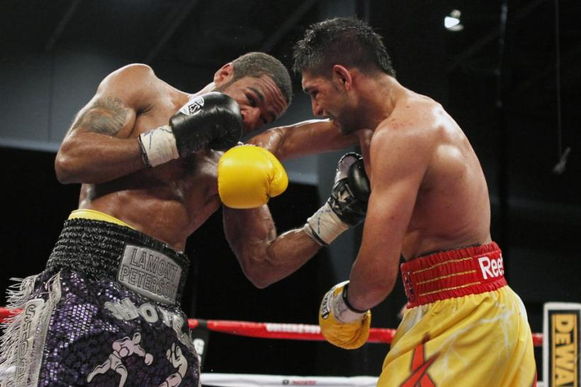 Lamont Peterson (L) and Amir Khan -December 10, 2011
