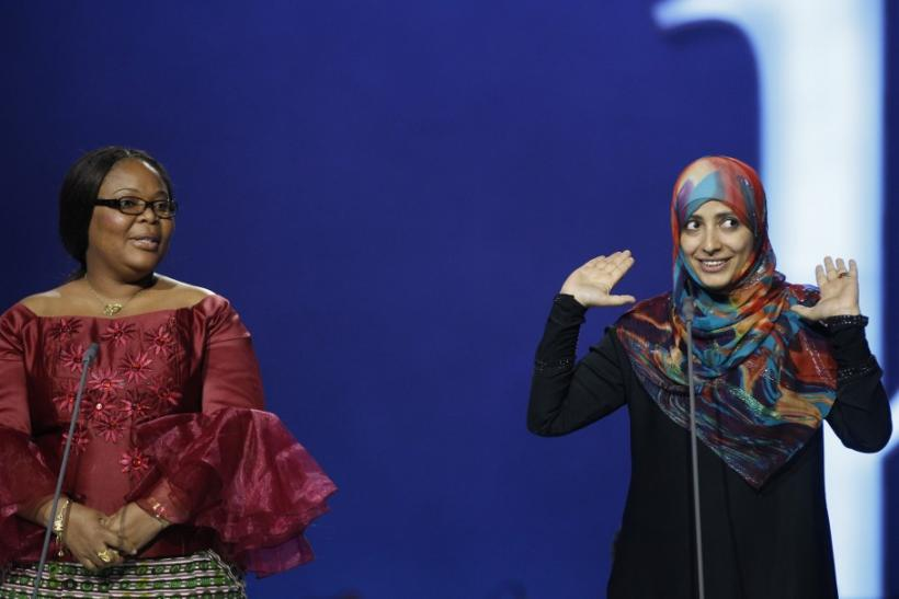 Nobel Peace Prize winners, Liberian peace activist Leymah Gbowee (L) and human rights activist Tawakul Karman from Yemen, appear on stage during the annual Nobel Peace Prize Concert in Oslo