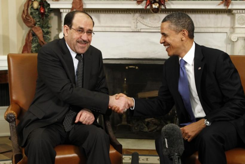U.S. President Barack Obama meets Iraqi Prime Minister Nuri al-Maliki in the White House in Washington