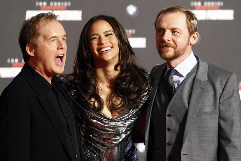 "Director Brad Bird and cast members Paula Patton and Simon Pegg (R) pose on the red carpet during the European premiere of the movie ""Mission Impossible: Ghost Protocol""(Phantom Protokoll) in Munich"