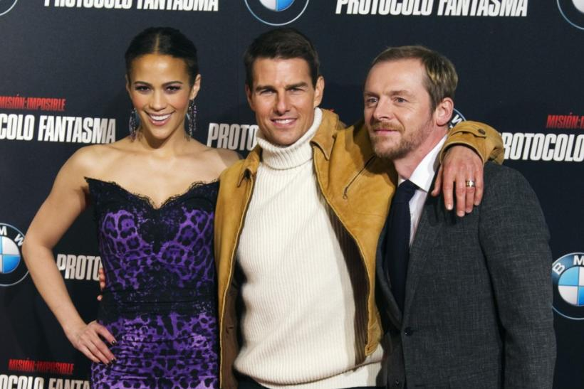 "U.S. actor Tom Cruise (C) poses with cast members Paula Patton and Simon Pegg (R) during a photocall to promote their latest film ""Mission Impossible: Ghost Protocol"" in central Madrid"