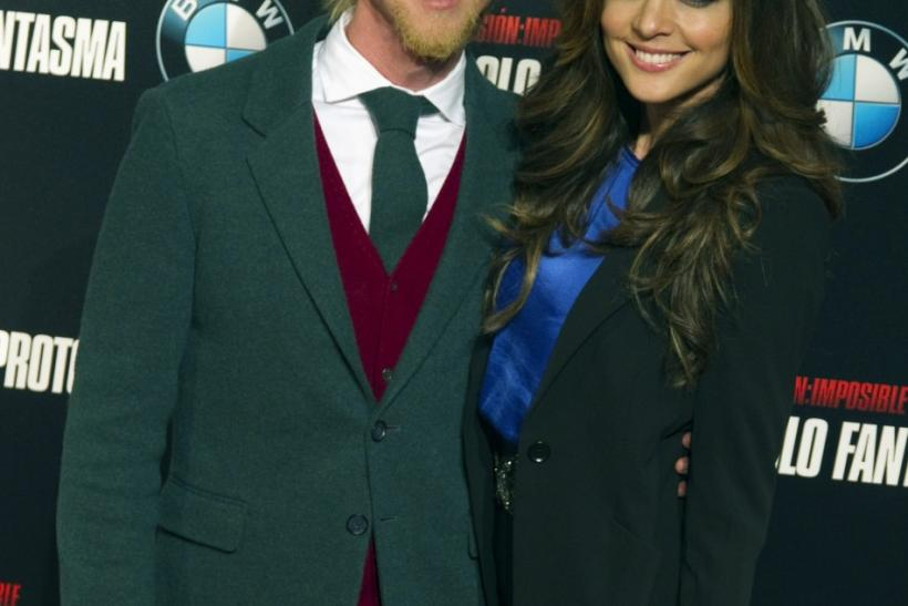 "Former Real Madrid and Besiktas soccer player Jose Maria Gutierrez ""Guti"" and his partner Romina Belluscio pose as they attend a photocall to promote the film ""Mission Impossible: Ghost Protocol"" in central Madrid"
