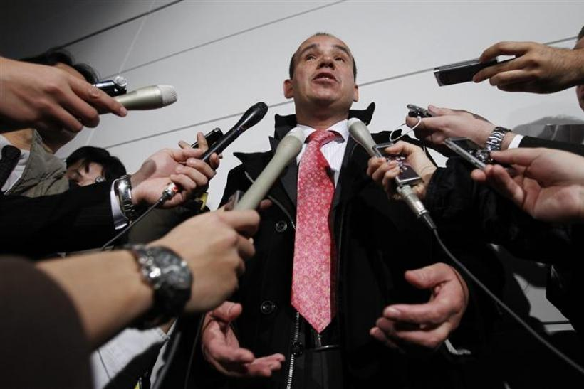 Former Olympus Corp CEO Michael Woodford speaks to reporters upon his arrival at Haneda airport in Tokyo