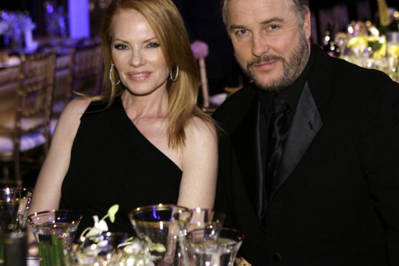 Marg Helgenberger and William Petersen from the cast of CSI sit together at the 14th annual Screen Actors Guild Awards in Los Angeles