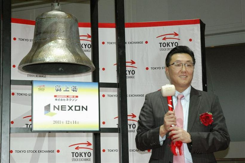 Nexon Co. President Choi Seung-woo poses prior to ringing a bell during a ceremony to mark the company's debut on the Tokyo Stock Exchange in Tokyo