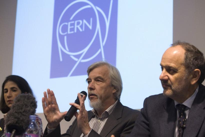 Heuer, CERN Director General, gestures next to Gianotti, ATLAS experiment spokesperson, and Tonelli, CMS experiment spokesperson, during news conference at CERN in Meyrin